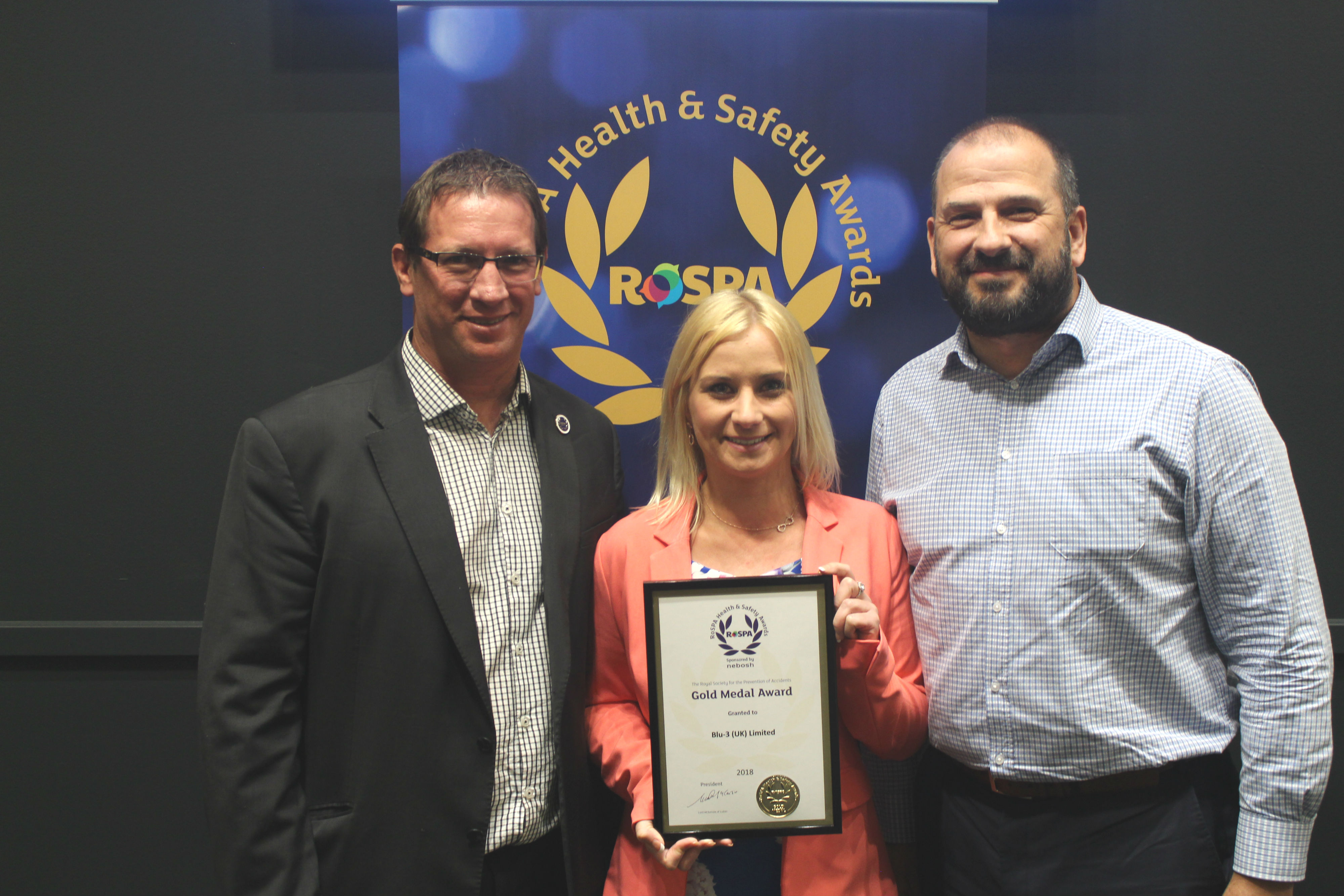 blu-3 RoSPA success - Coenraad Fourie, Phil Douce and Linda Daly from blu-3 collect the award